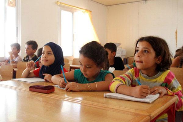 Una quarta elementare nel campo per sfollati di Al Karnak, nella città siriana di Tartous - ©UNICEF/UN013173/Saker