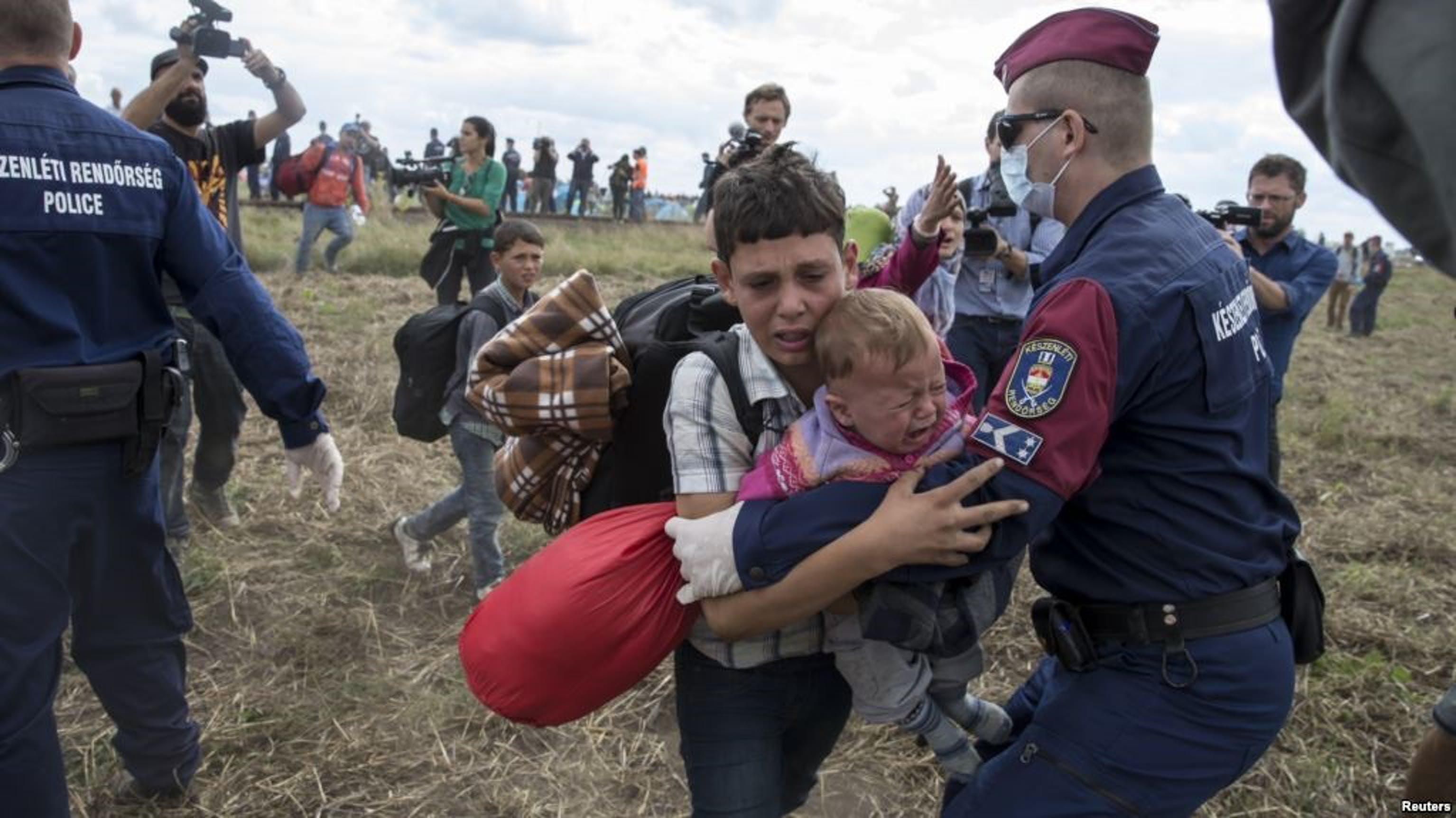 Migranti alla frontiera con l'Ungheria (settembre 2015) - ©Reuters