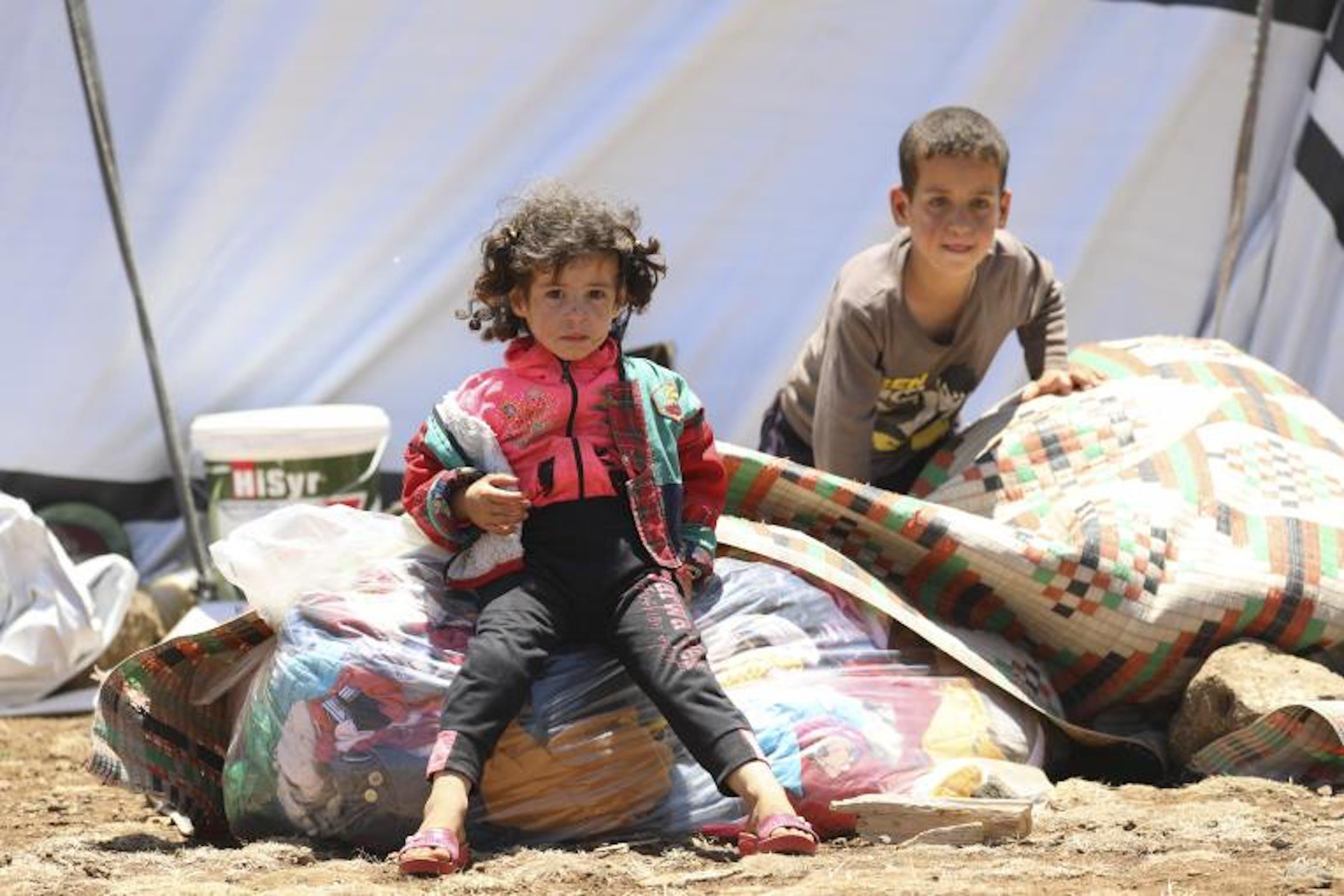 Una famiglia evacuata da Dera'a, nel sud della Siria - ©UNICEF/Alaa Al-Faqir