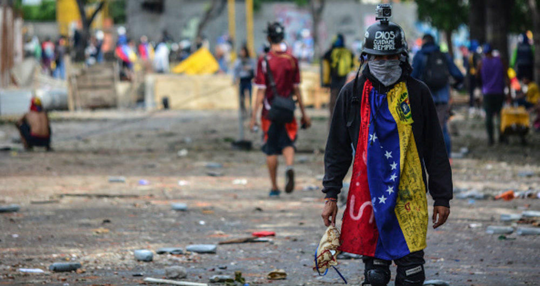 Un'immagine degli scontri in Venezuela