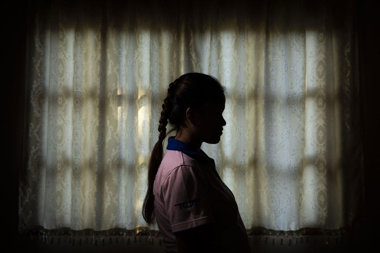 Una giovanissima vittima della tratta in un centro di accoglienza a Vientiane, capitale del Laos - ©UNICEF/UN0269025/Brown