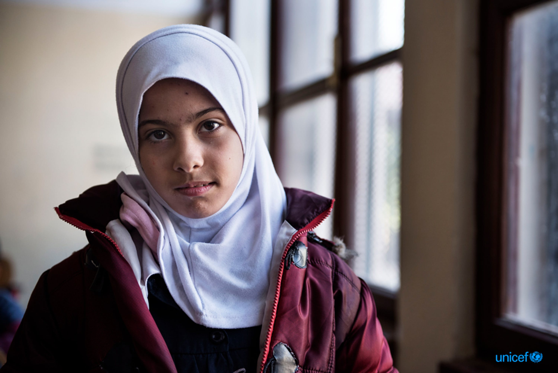 Libia, Tripoli - Nada, una bambina di nove anni, nell'aula della scuola El Hadana di Zanzur,