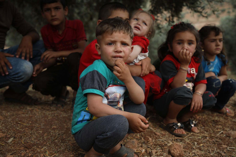 Bambini in una tendopoli a nord di Idlib (Siria) - ©UNICEF/UN0318491/Watad