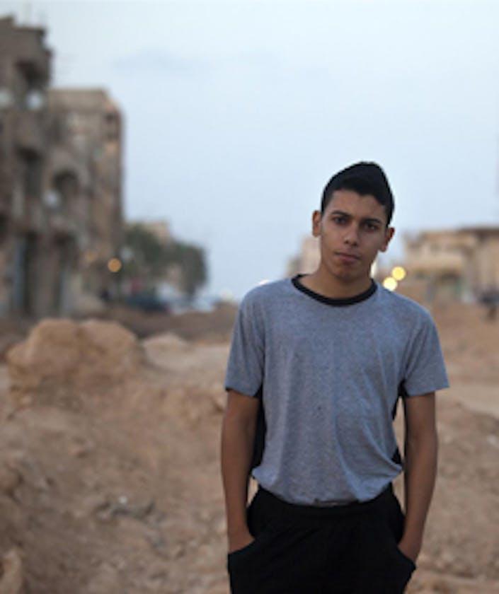 Sidiq, 18 anni, fotografato nel quartiere al-Whishi d Bengasi - ©UNICEF/NYHQ2011-0971/Ramoneda