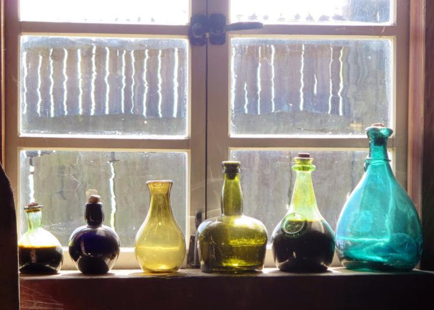 dusty-bottles-windowsill
