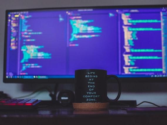 monitor and a coffee mug