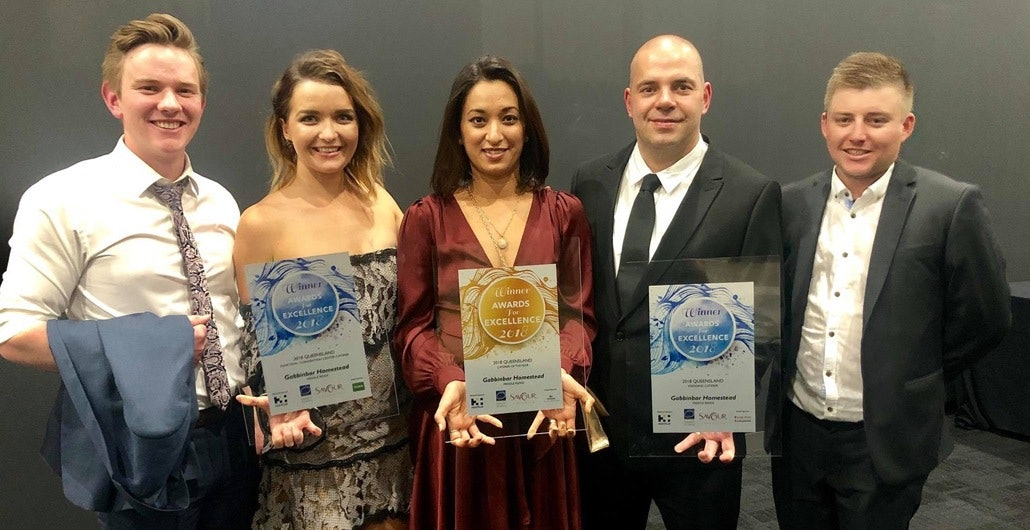 Group stands with restaurant award