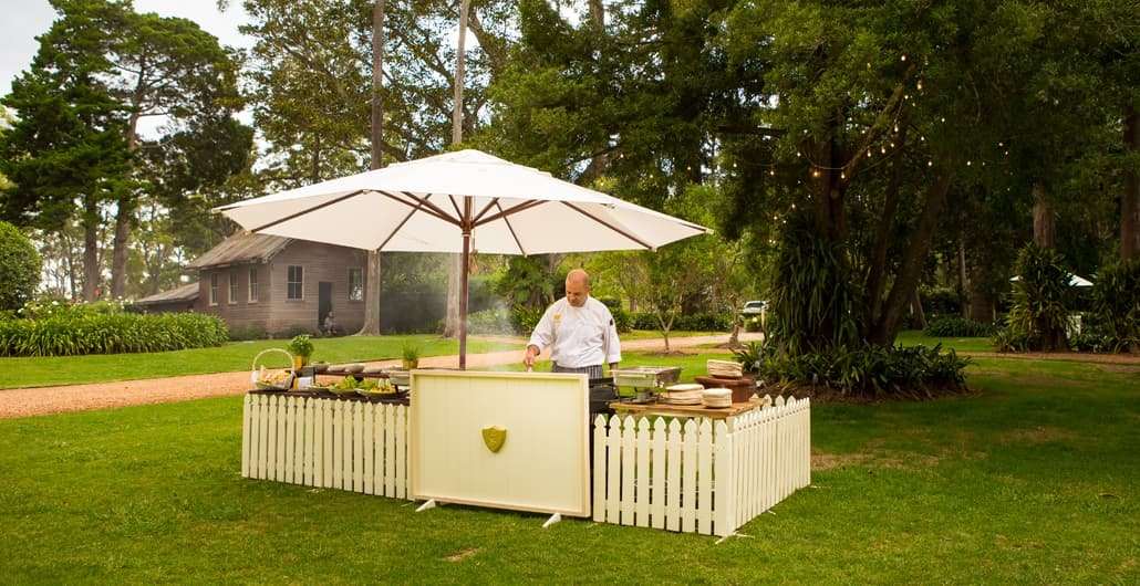 Chef cooks on a barbecue in garden