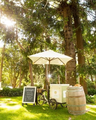 Ice cream cart in garden with chalk board