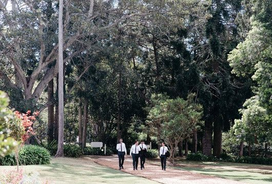 Groomsmen walking into Gabbinbar Homestead