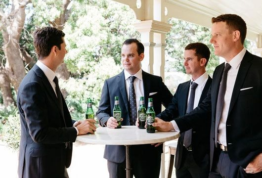 Brett with his groomsmen in suits