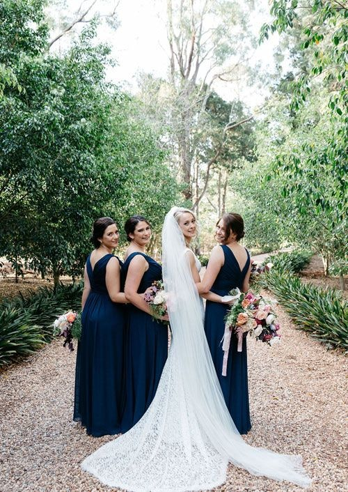 Bride with her bridesmaids in the garden