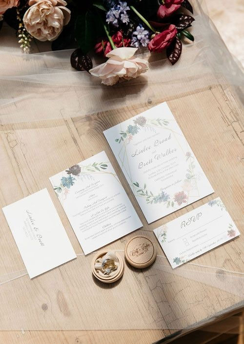 Wedding invitations on the table with flowers