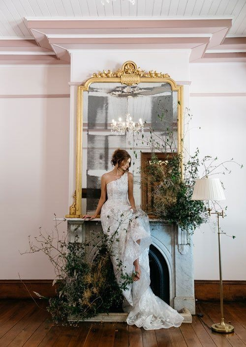 Bride Sitting in Front of the Fireplace