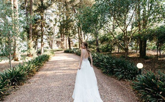 Bride Walking in the Garden Aisle