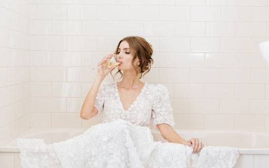 Bride With White Dress Drinking Wine In Bath Tub