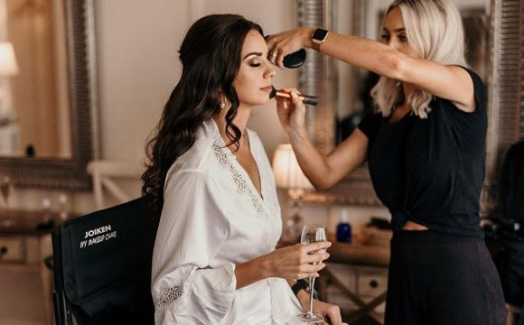 Bride getting her make-up ready