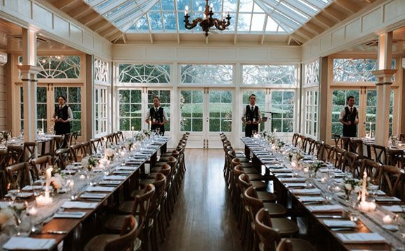Long timber trestle tables with candles
