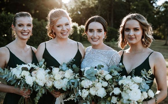 Eloise and her 3 bridesmaid smiling sweetly