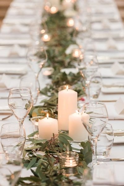 Glassware on the tables with candles as centerpieces