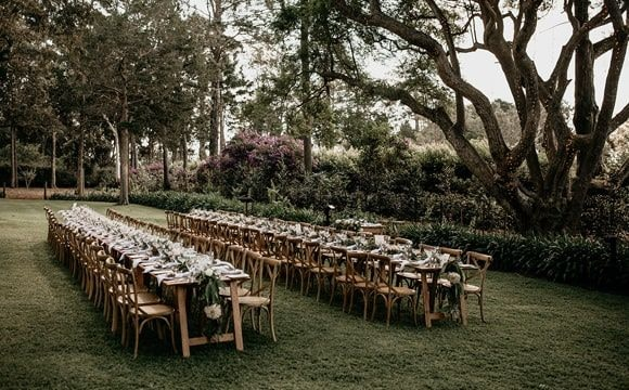Beautiful outdoor wedding set-up of table and chairs in the garden