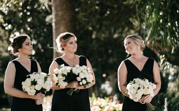 Bridesmaids dressed in black gowns