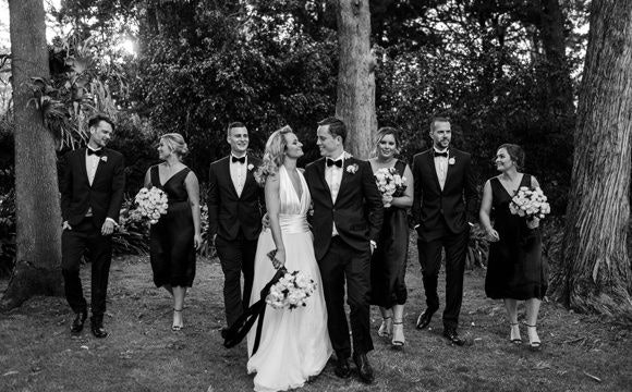 Black and white photos of sweet couple with their bridesmaids and groomsmen