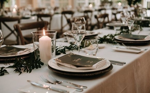 Sophisticated wedding reception with star jasmine and candles