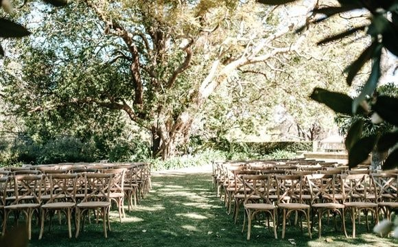 Wedding venue set-up with chairs in the garden