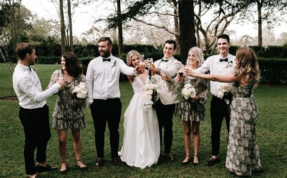 Happy bride and groom with their bridesmaids and groomsmen