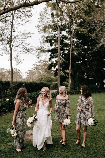 Bride with bridesmaids in unique floral dresses