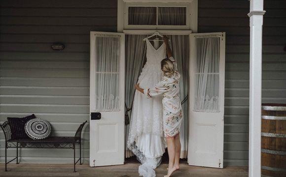 Philippa hanging her wedding dress at the open door