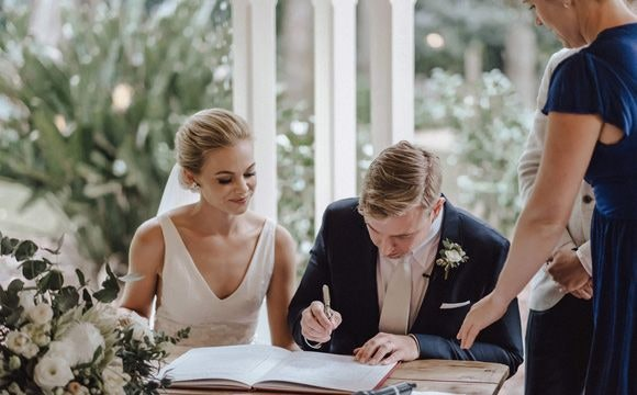 Benjamin and Philippa signing their marriage certificate
