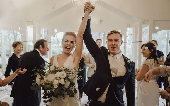 Benjamin and Philippa celebrating as newly wed couple