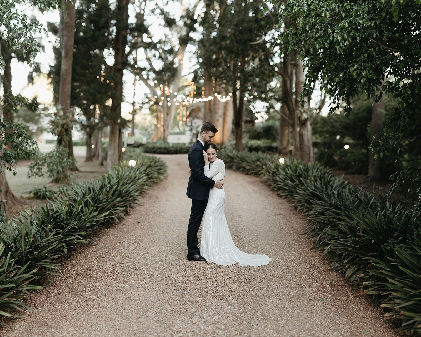 Couple hug on Gabbinbar Homestead driveway