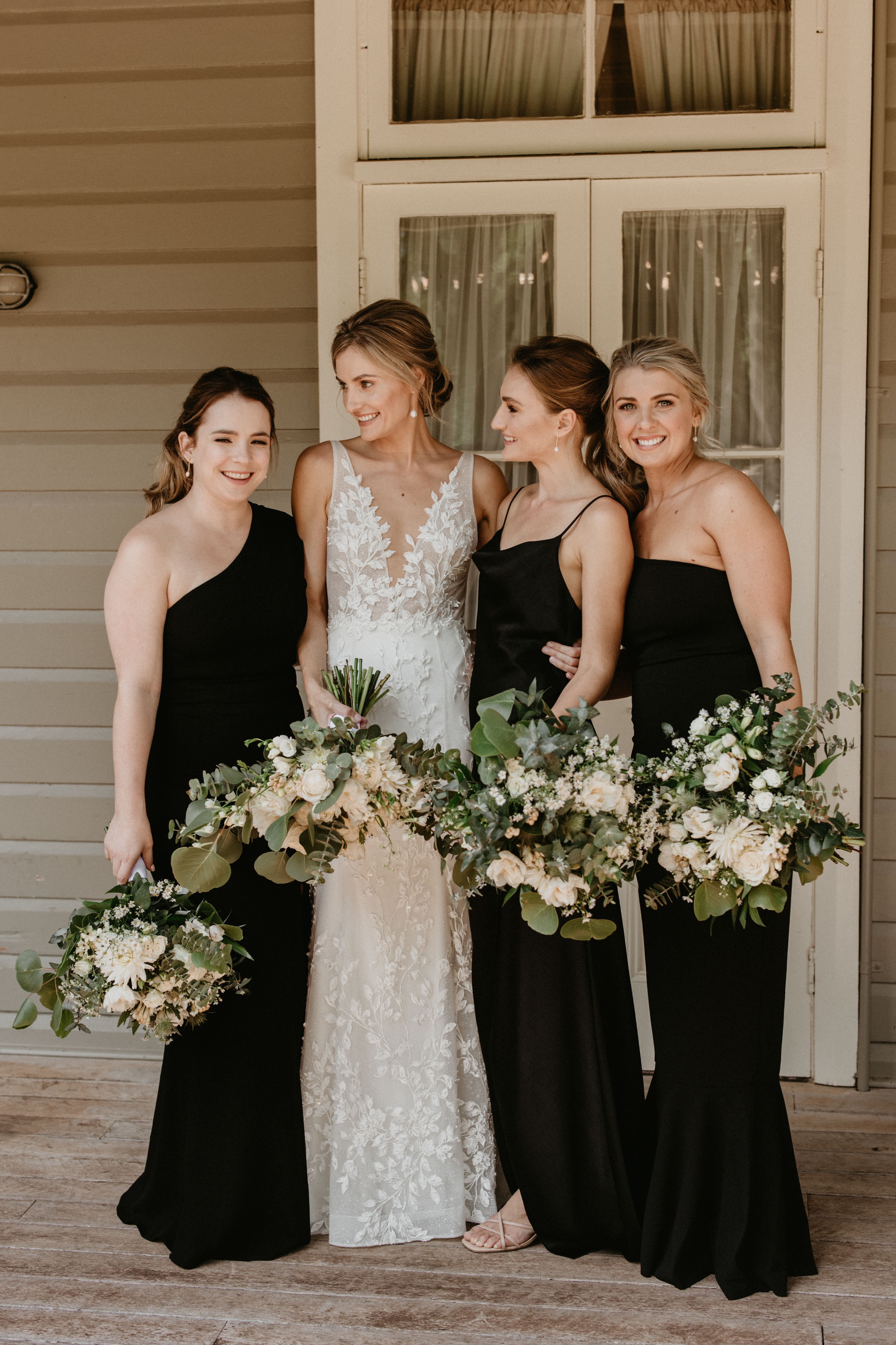 Bride and bridesmaids getting ready on morning of wedding