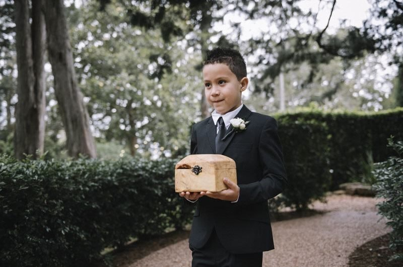 Boy In Suit Holding Small Wooden Treasure Chest