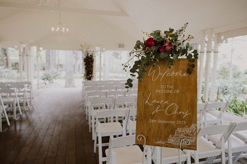 Wooden welcome Board With Flowers for wedding ceremony