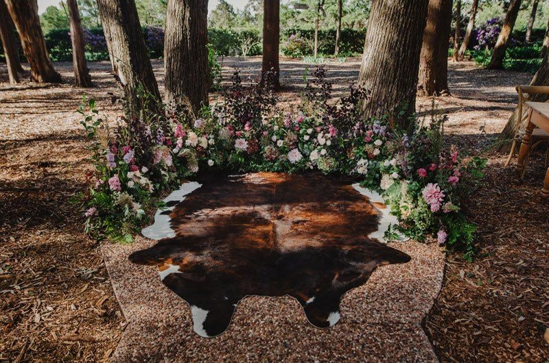 Cow hide with boho flowers for ceremony