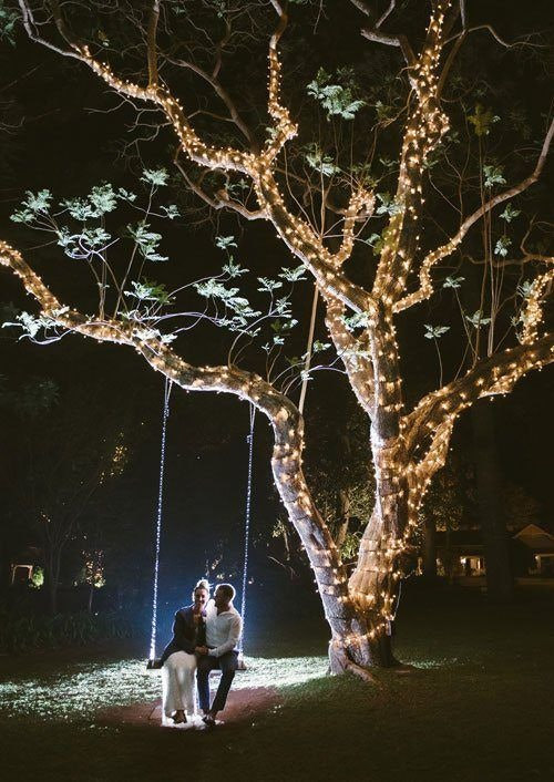 Sweet Couple Sitting on The Swing at night time