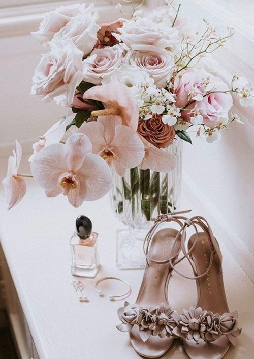 Flowers on The Table with A Pair of Heels, Accessories and Perfume