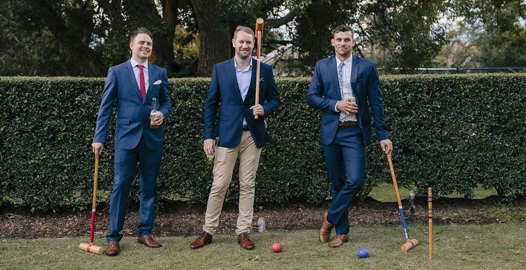 Groom and Bride with Wedding Guest Playing an Outdoor Game