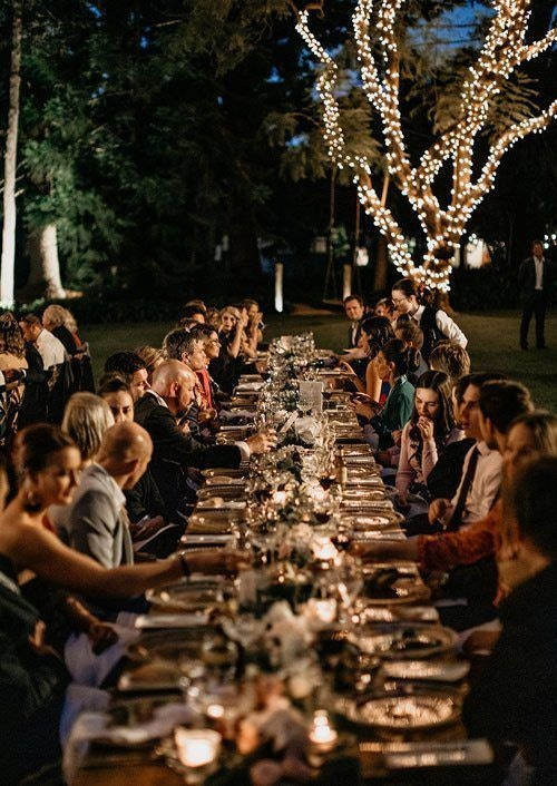 Guests talking to each other during outdoor reception