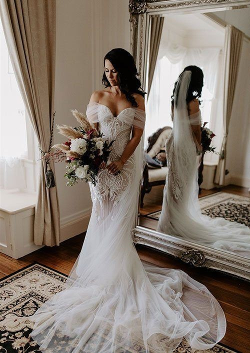 Bride in brides retreat with sheer skirting on gown