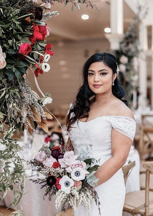 Bride in the conservatory with beautiful flowers