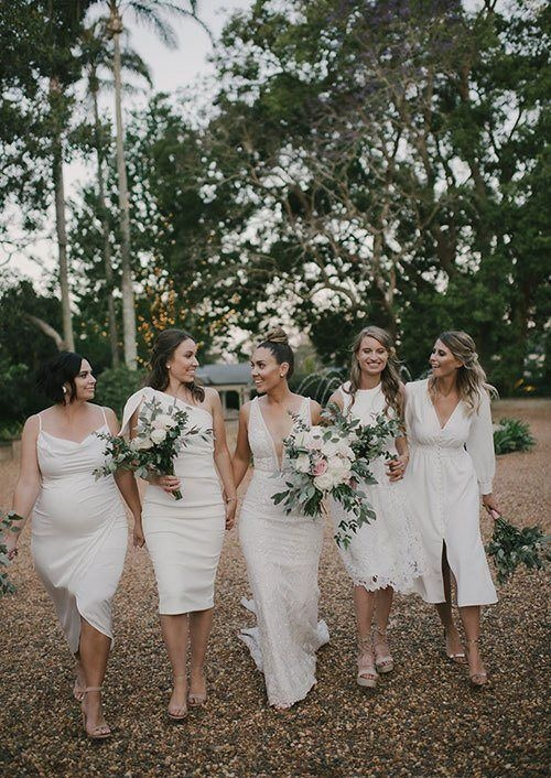 Bride walks with her bridesmaids all in white