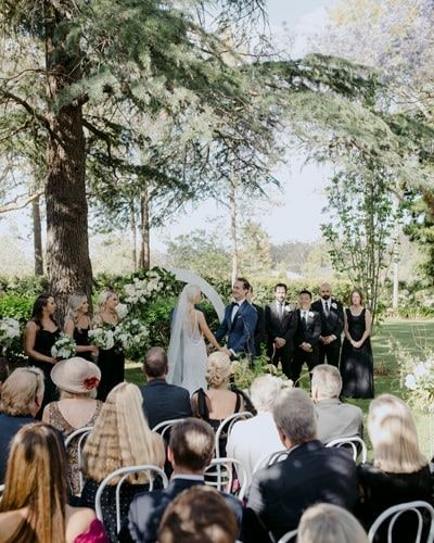 Couple say their vows under large tree