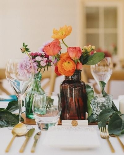 Wedding table decorations using dark coloured bottles