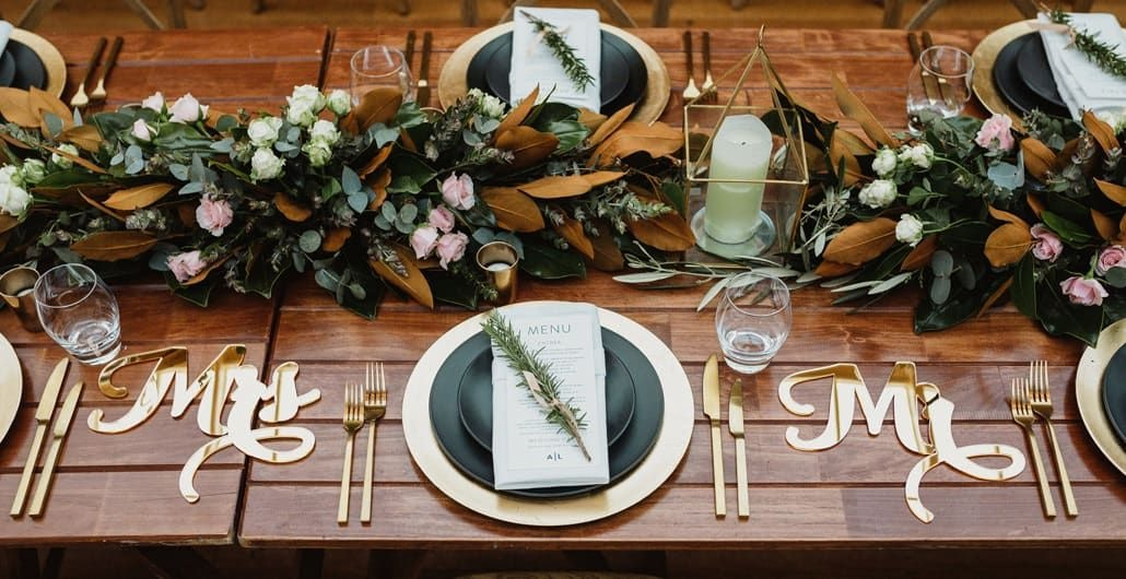 Wedding table arrangement with Mr and Mrs in gold perspex