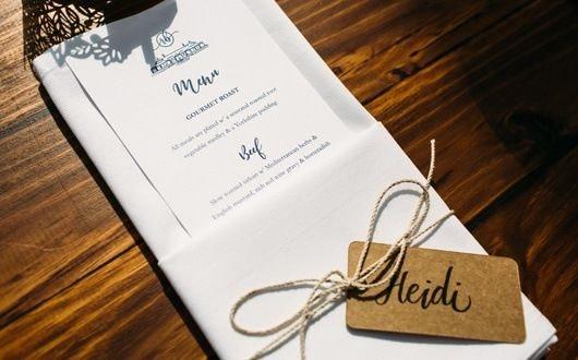 White napkin folded with wedding menu inserted in fold